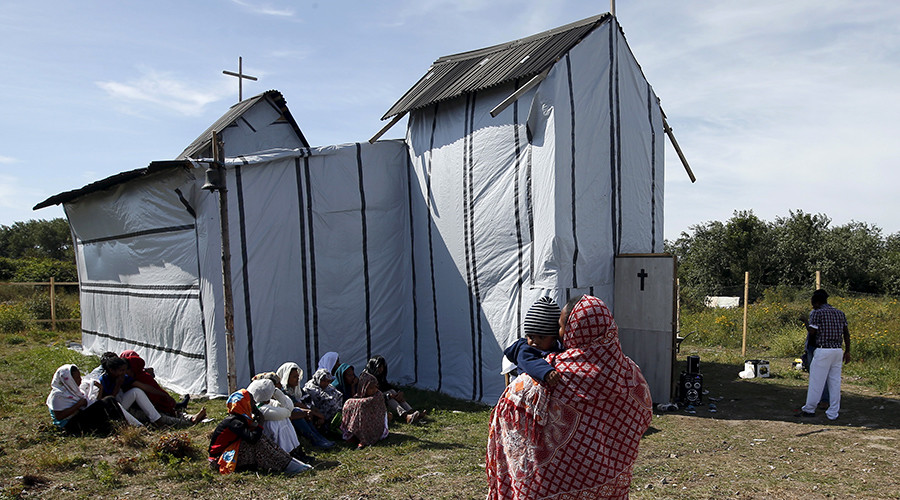 "Christian migrants from Eritrea and Ethiopia attend the Sunday mass at the makeshift church in ""The New Jungle"" near Calais, France, August 2, 2015 © Pascal Rossignol"