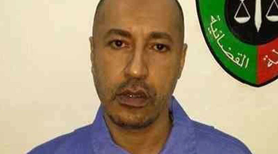 Saadi Gaddafi, son of Muammar Gaddafi, looks on inside a prison in Tripoli in this handout photograph provided by the prison's relations department on March 6, 2014. © Prison Media Office
