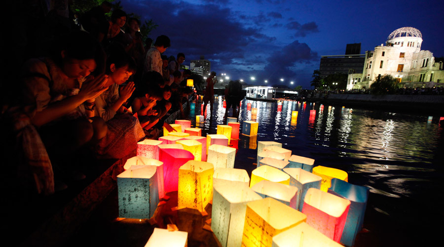 People pray after releasing paper lanterns on a river facing the gutted Atomic Bomb Dome in remembrance of atomic bomb victims on the 66th anniversary of the bombing in Hiroshima August 6, 2011 © Kim Kyung-Hoon