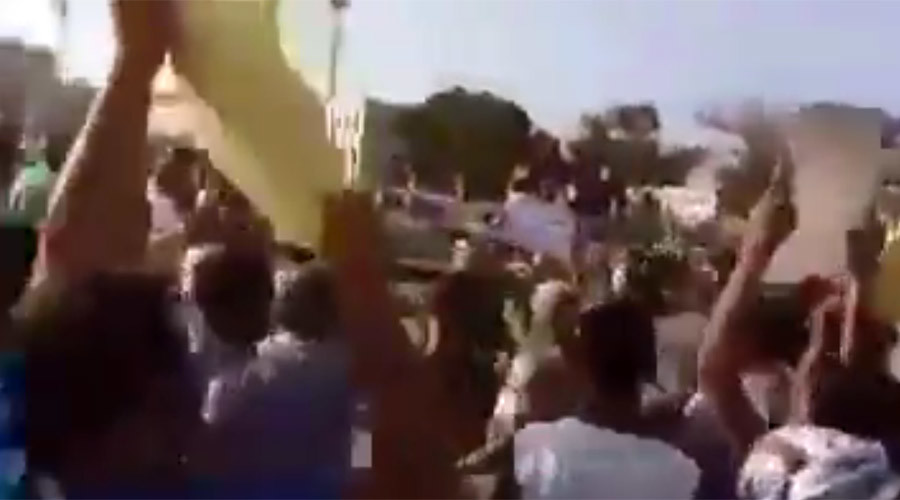 'Muammar! Muammar!' Pro-Gaddafi demonstration in Benghazi dispersed with rocks, gunfire