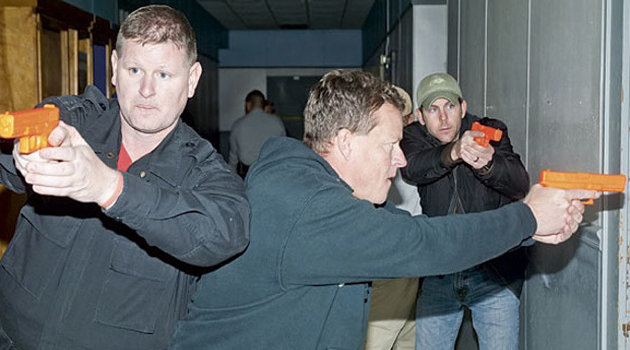 Clay County sheriff's department investigator Billy Cooper, Alexander City fire department captain Reese McAlister and patrolman Troy Middlebrooks participate in an active shooter drill in 2011.  © Alexander City police department