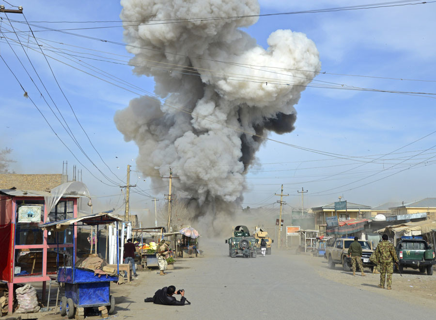Smoke rises in the sky after a suicide car bomb attack in Kunduz province February 10, 2015. © Stringer Afghanistan