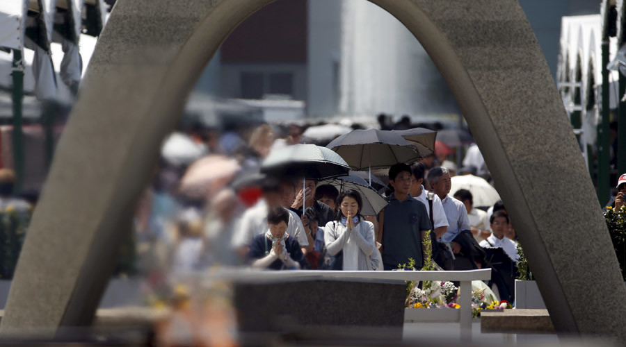 People pray for victims in front of the cenotaph for the victims of the 1945 atomic bombing, at Peace Memorial Park in Hiroshima, western Japan, August 6, 2015. © Toru Hanai
