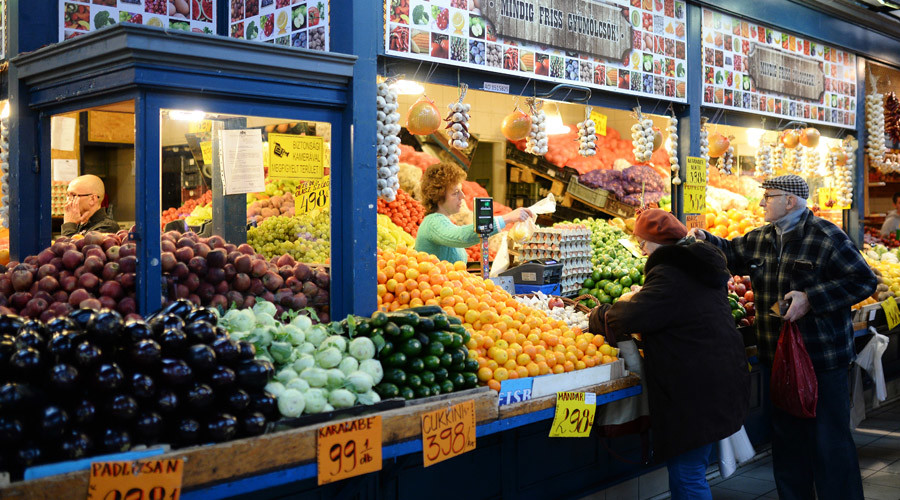 Customers at a fruit and vegetables counter at the Central Market Hall in Budapest. © Vladimir Pesnya