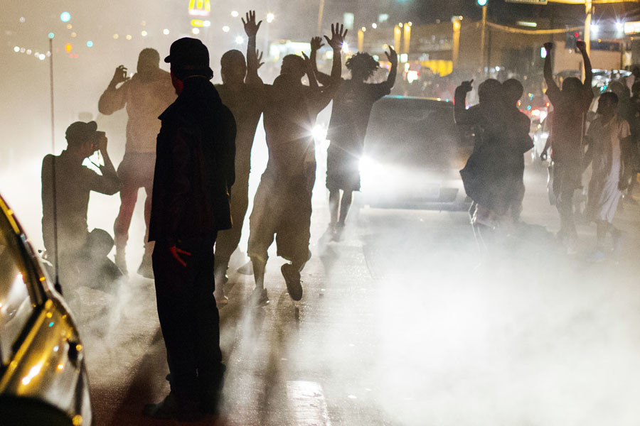 Protesters chant during a peaceful demonstration as communities continue to react to the shooting of Michael Brown in Ferguson, Missouri August 15, 2014. © Lucas Jackson