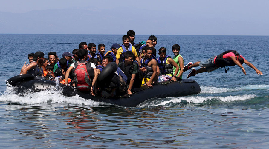 A dinghy overcrowded with Afghan immigrants approaches the Greek island of Lesbos after crossing a part of the Aegean Sea between Turkey and Greece, August 6, 2015. © Yiannis Kourtoglou