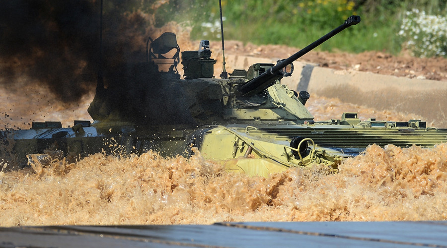 A Russian Army's combat infantry vehicle crew takes part in The Suvorov Assault competition at the International Army Games 2015 at Alabino base outside Moscow. © Ramil Sitdikov