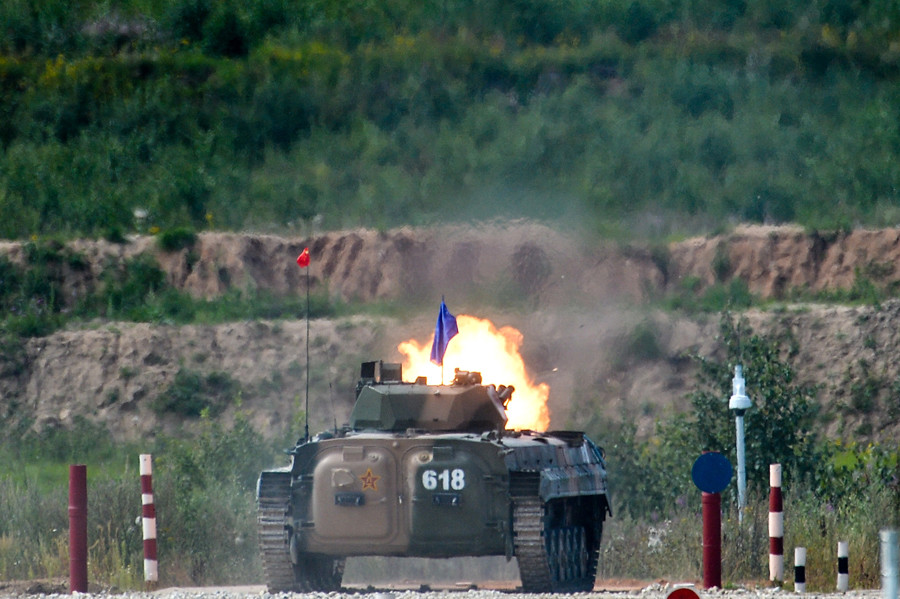 A Chinese Army's combat vehicle infantry crew takes part in The Suvorov Assault competition at the International Army Games 2015 at Alabino base outside Moscow. © Ramil Sitdikov