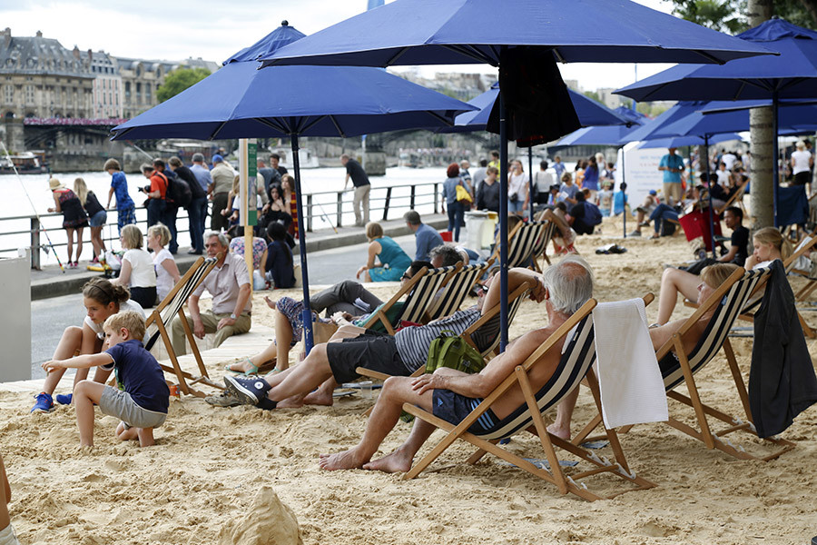 "People relax on deckchairs as ""Paris Plages"" (Paris Beach) opens along the banks of River Seine in Paris, France, July 20, 2015. © Charles Platiau"