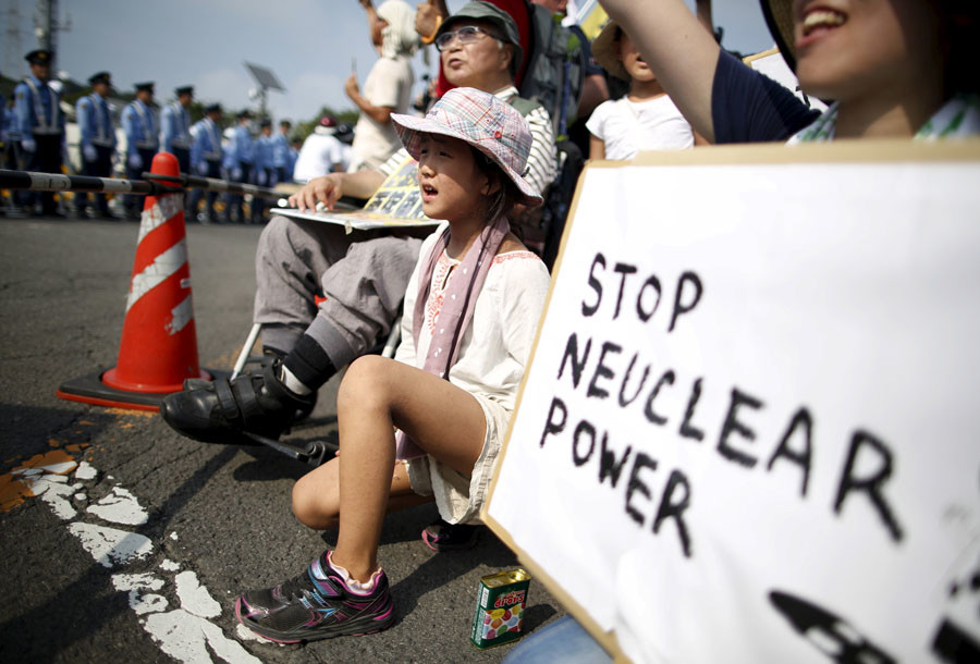 People shout slogans during a rally against the restarting of Kyushu Electric Power's Sendai nuclear power station in Satsumasendai, Kagoshima prefecture, Japan, August 9, 2015. © Issei Kato