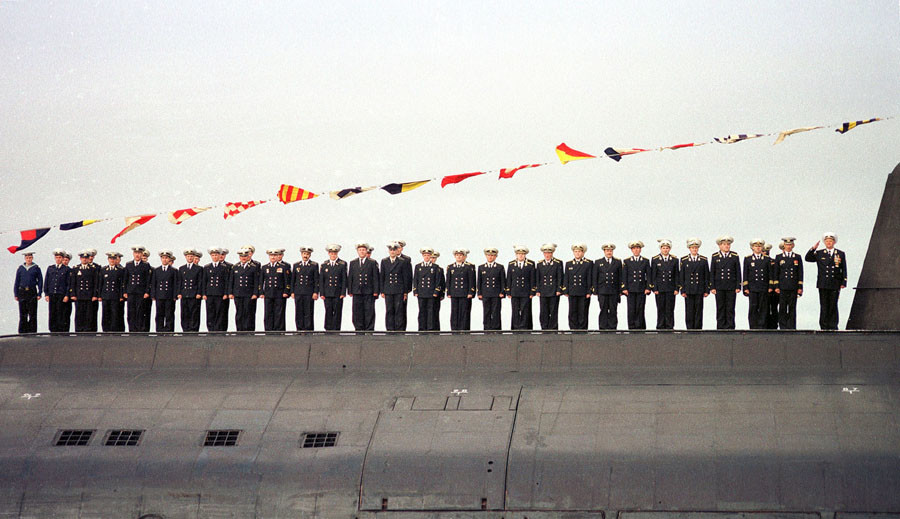A July 30, 2000 file picture shows the crew of the sunken Russian submarine Kursk lead by Captain Grigory Lyachin (R) during a naval parade which was held in Severomorsk. © Reuters