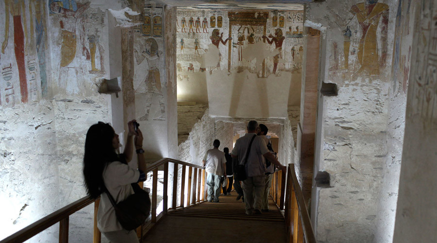 Tourists take pictures of paintings on the walls of King Merenptah's tomb from the 19th dynasty, around the year, 1200 B.C. in the Valley of the Kings in Luxor © Asmaa Waguih