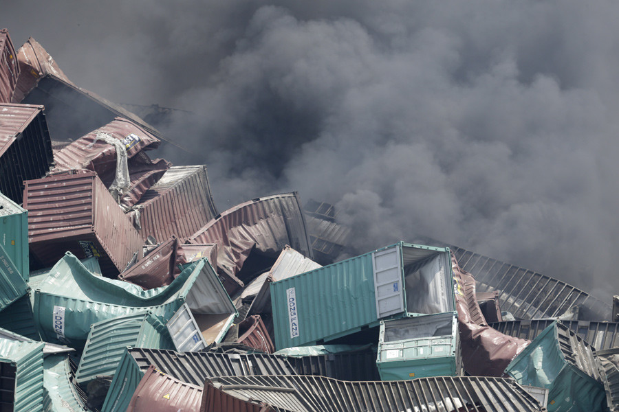 Smoke rise from container boxes near the site of the explosions at the Binhai new district, Tianjin, August 13, 2015. © Jason Lee