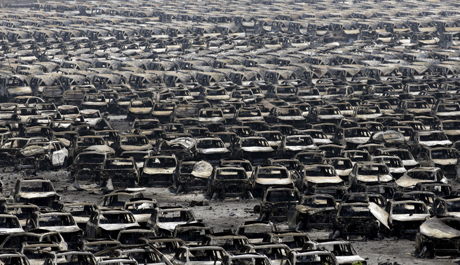 Damaged cars are seen near the site of the explosions at the Binhai new district, Tianjin, August 13, 2015. © Jason Lee