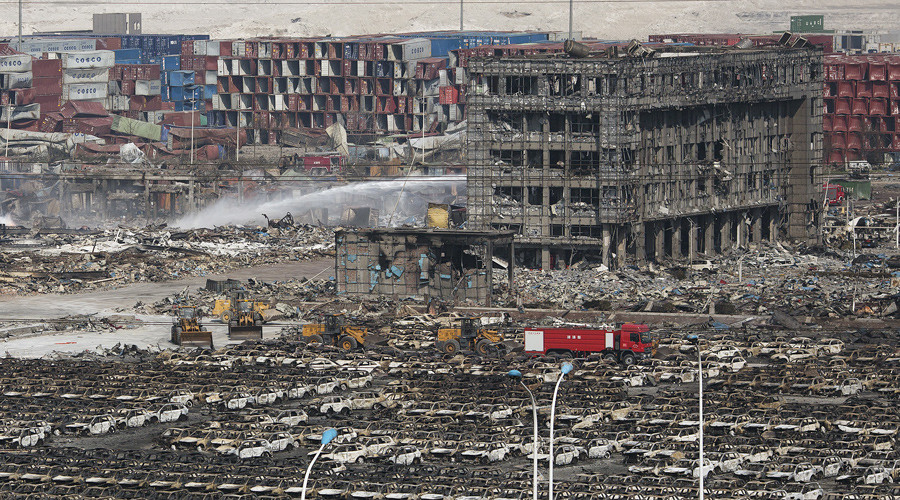 Firefighters work at the site of the explosions at the Binhai new district, Tianjin, August 13, 2015. © Damir Sagolj
