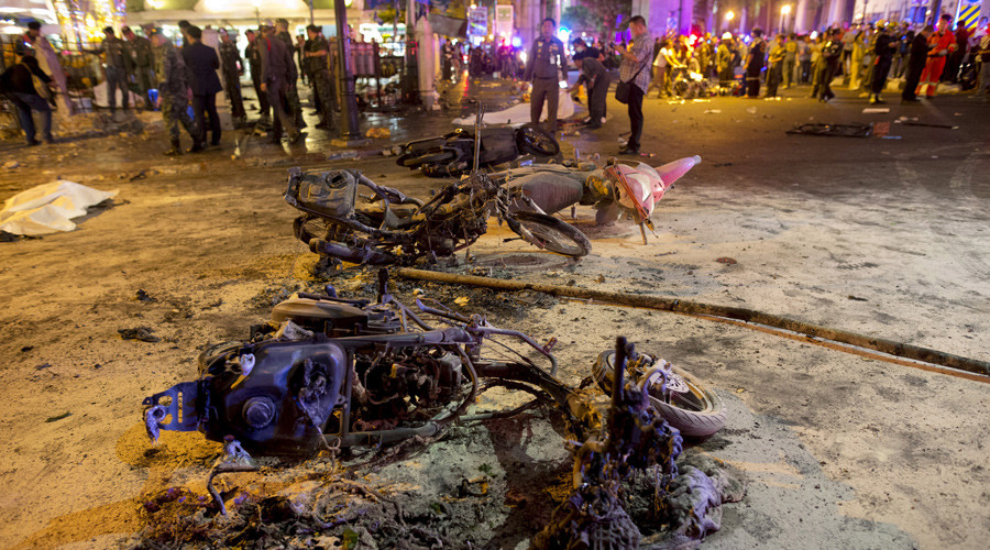 Wreckage of motorcycles are seen as security forces and emergency workers gather at the scene of a blast in central Bangkok August 17, 2015. © Athit Perawongmetha