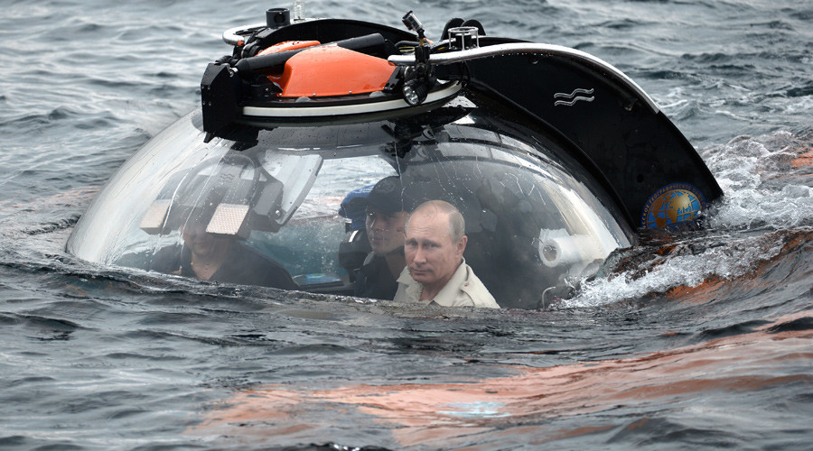 Russian President Vladimir Putin (foreground) submerges 83 meters under water on board a bathyscaphe near Sevastopol to see a sunken ancient vessel. © Aleksey Nikolskyi