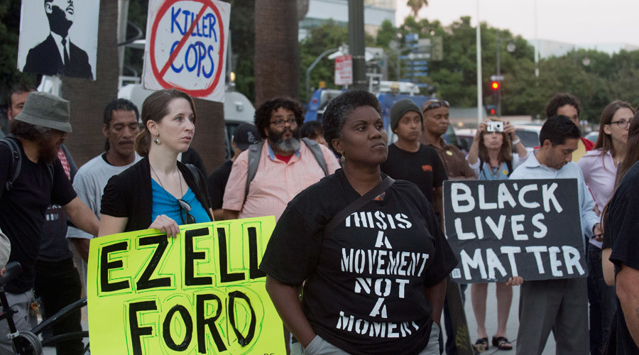 """Protestors carry signs during a demonstration by """"Black Lives Matter"""" in Los Angeles, California August 11, 2015 ©Phil McCarten"""