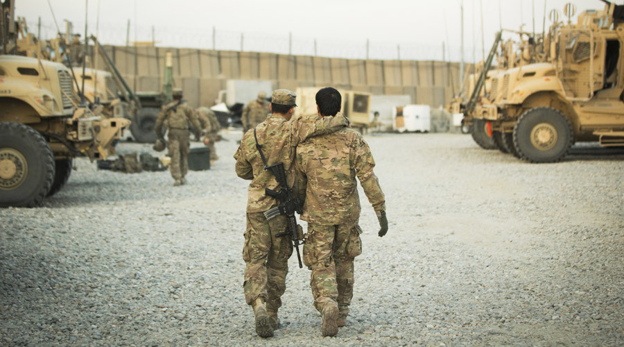 A U.S. soldier from the 3rd Cavalry Regiment walks with the unit's Afghan interpreter before a mission near forward operating base Gamberi in the Laghman province of Afghanistan. © Lucas Jackson