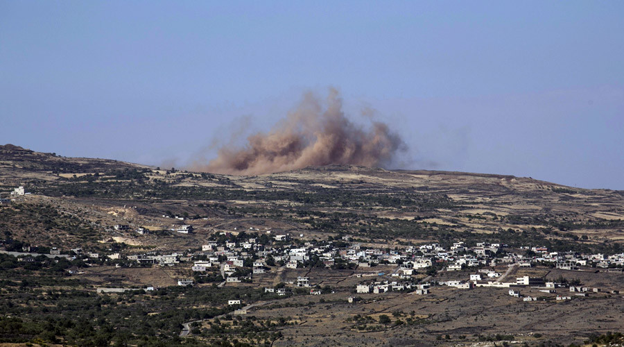 Smoke rises during fighting in the Druze village of Khadr in Syria, as seen from the Israeli side of the border fence between Syria and the Israeli-occupied Golan Heights, near Majdal Shams, June 16, 2015.  © Baz Ratner