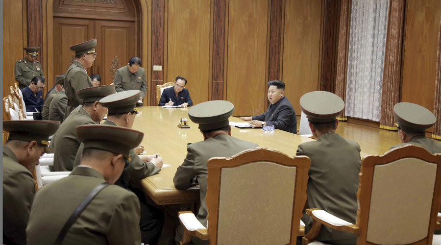 North Korean leader Kim Jong Un (3rd R) speaks at an emergency meeting of the Workers' Party of Korea (WPK) Central Military Commission, in this undated photo released by North Korea's Korean Central News Agency (KCNA) in Pyongyang on August 21, 2015. © KCNA