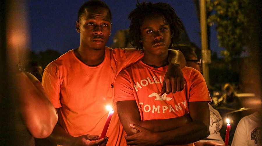 James Cody (L) and his cousin Dennis Ball-Bey attend a candlelight vigil for Mansur Ball-Bey in St. Louis, Missouri, United States, August 20, 2015 © Lawrence Bryant