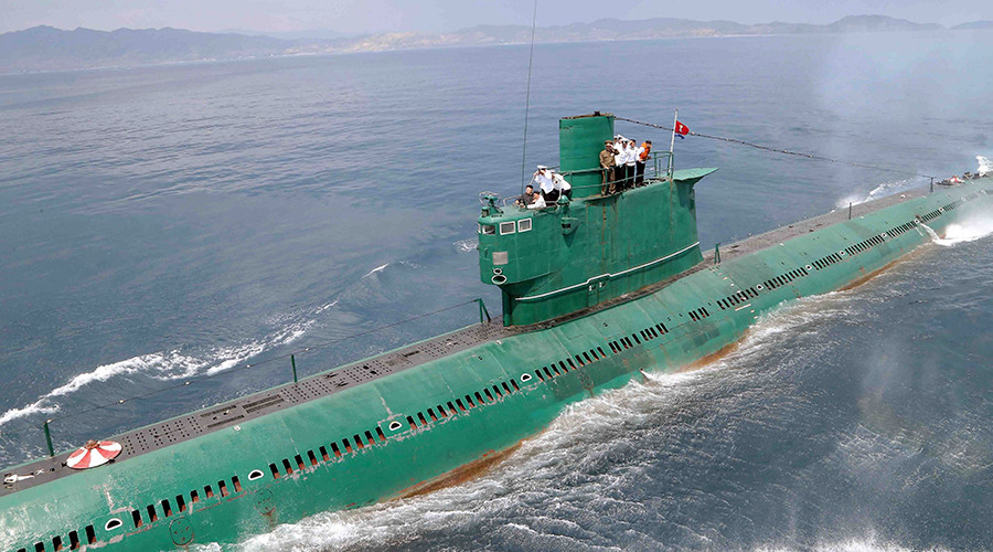North Korean leader Kim Jong Un (L) stands on the conning tower of a submarine during his inspection of the Korean People's Army (KPA) Naval Unit 167 © KCNA