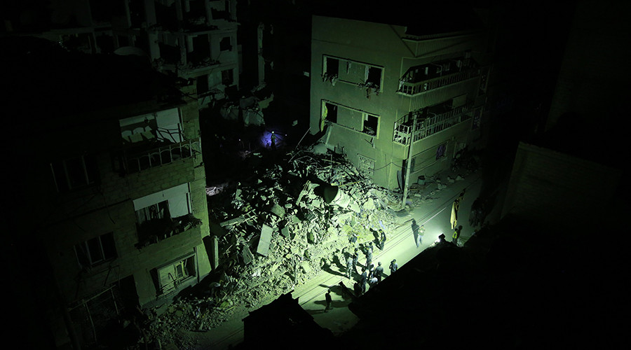 Syrian rescue workers and civilians search for victims under the rubble of collapsed buildings late on August 22, 2015 following shelling and air raids by Syrian government forces in the rebel-held area of Douma, east of the capital Damascus. © Abd Doumany