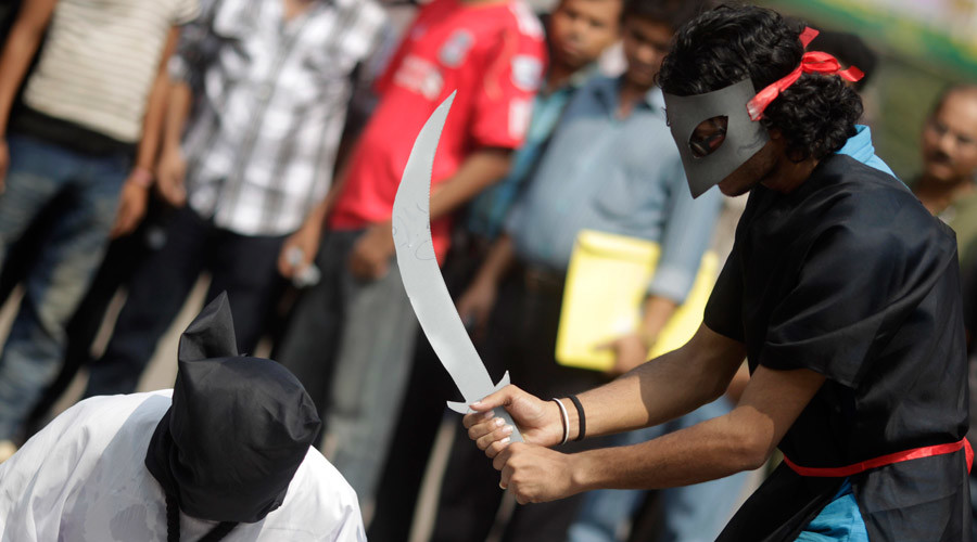 Members of Magic Movement, a group of young Bangladeshis, stage a mock execution scene in protest of Saudi Arabia beheading of eight Bangladeshi workers in front of National Museum in Dhaka October 15, 2011. © Andrew Biraj