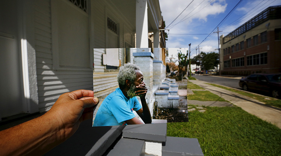Photographer Carlos Barria holds a print of a photograph he took in 2005, as he matches it up at the same location 10 years on, in New Orleans, United States, August 17, 2015 © Carlos Barria