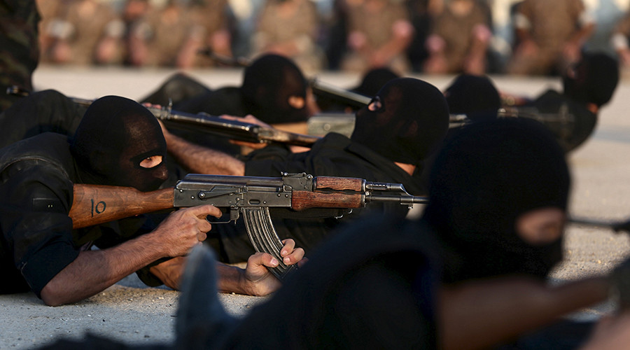 Rebel fighters aim their weapons as they demonstrate their skills during a military display as part of a graduation ceremony at a camp in eastern al-Ghouta, near Damascus, Syria. © Bassam Khabieh