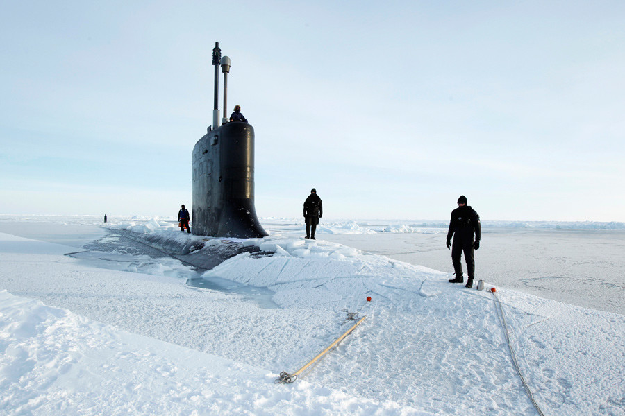 U.S. Navy safety swimmers stand on the deck of the Virginia class submarine USS New Hampshire after it surfaced through thin ice during exercises underneath ice in the Arctic Ocean north of Prudhoe Bay, Alaska © Lucas Jackson