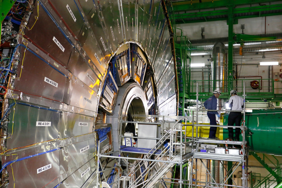 Technicians are seen working in the Compact Muon Solenoid (CMS) experiment, part of the Large Hadron Collider (LHC), during a media visit to the Organization for Nuclear Research (CERN) in the French village of Cessy, near Geneva in Switzerland © Pierre Albouy