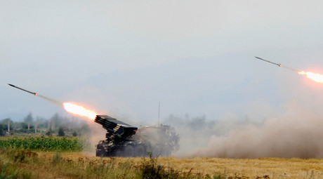 Georgian troops fire rockets at a South Ossetian territory near the city of Tskhinvali, August 8, 2008. © Irakli Gedenedze