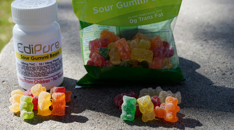 Marijuana-infused sour gummy bear candies (L) are shown next to regular ones at right in a photo illustration near to where they were purchased in Northglenn, Colorado © Rick Wilking