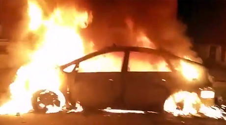 Car on fire during a protest in St. Louis on August 19, 2015 @search4swag