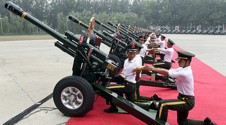 Paramilitary policemen and members of a gun salute team load cannons during a training session for a military parade to mark the 70th anniversary of the end of the World War Two, at a military base in Beijing, China, August 1, 2015 © HO