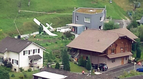 One of two planes which crashed during an air show is seen in the village of Dittingen, Switzerland, in this handout photo provided by Kantonspolizei Basel Landschaft on August 23, 2015. © Kantonspolizei Basel Landschaft / Handout via Reuter