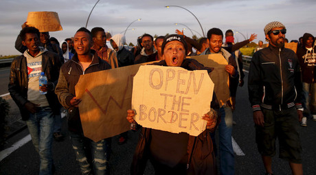 African migrants shout slogans during a protest on a motorway in Calais, France, August 7, 2015. © Juan Medina
