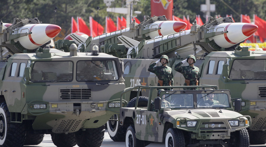 Missiles are displayed in a parade to celebrate the 60th anniversary of the founding of the People's Republic of China, in Beijing © Jason Lee