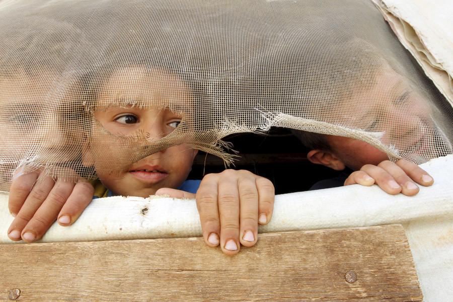Syrian refugee children in Saadnayel in Lebanon's Bekaa Valley © Mohamed Azakir