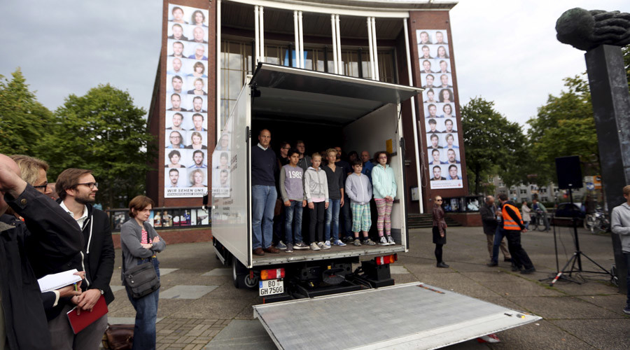 Seventy-one people stand in a truck during a public re-enactment referring to the 71 dead refugees found in the back of an abandoned truck, in Bochum, Germany September 2, 2015. © Ina Fassbender