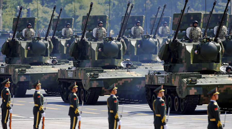 China's People's Liberation Army (PLA) soldiers on their armoured vehicles equipped with anti-aircraft artillery roll to Tiananmen Square during the military parade marking the 70th anniversary of the end of World War Two, in Beijing, China, September 3, 2015. © Damir Sagolj