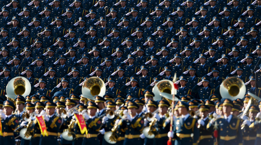 Chinese soldiers salute in a chorus on a stage during a military parade at Tiananmen Square in Beijing on September 3, 2015, to mark the 70th anniversary of victory over Japan and the end of World War II. © Wang Zhao