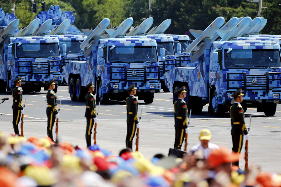 China's People's Liberation Army (PLA) navy soldiers on their armoured vehicles carrying ship-to-air missiles roll to Tiananmen Square during the military parade marking the 70th anniversary of the end of World War Two, in Beijing, China, September 3, 2015. © Damir Sagolj