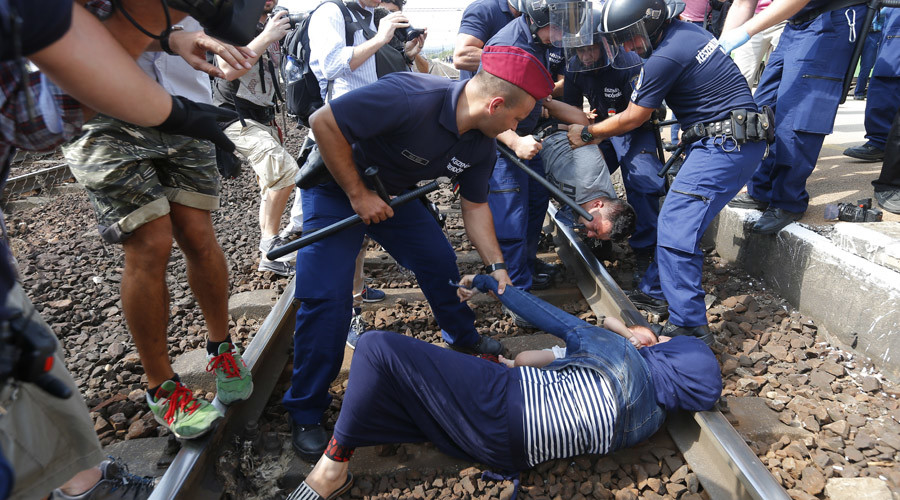 Hungarian police remove desperate refugee family protesting on rail tracks (VIDEO)