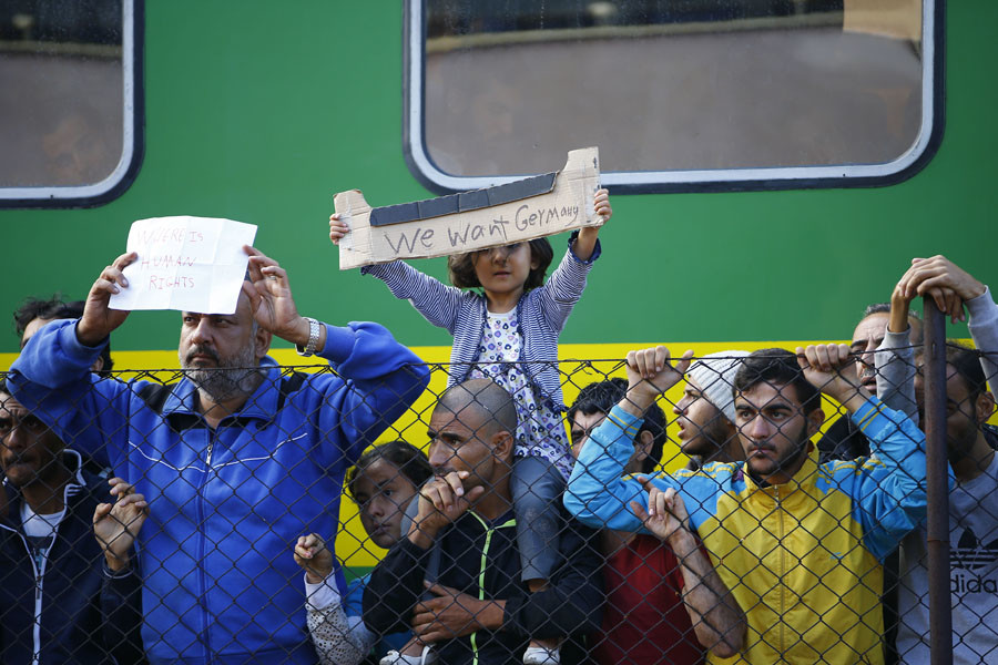 Migrants stage a protest in front of a train at Bicske railway station, Hungary, September 4, 2015. © Leonhard Foeger