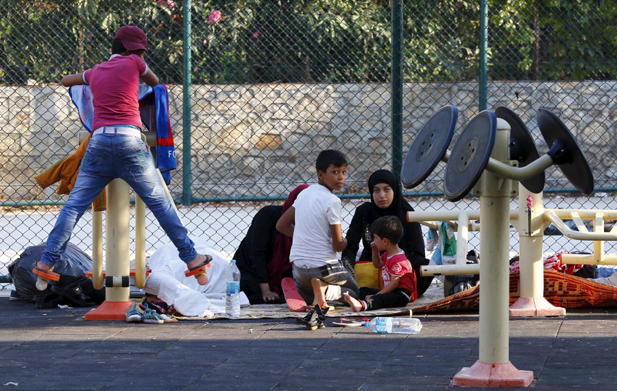 A Syrian family takes shelter at a playground in the resort town of Bodrum, Turkey, September 4, 2015. © Murad Sezer