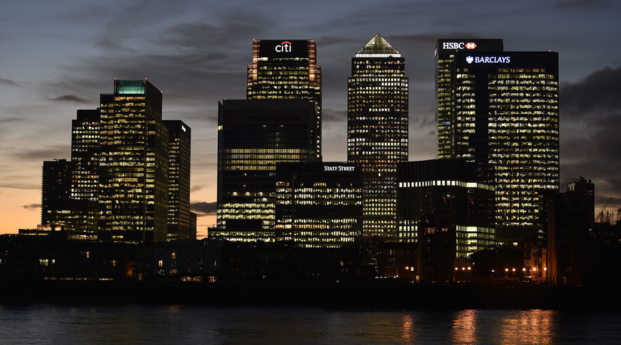 The Canary Wharf financial district is seen at dusk in east London. © Toby Melville