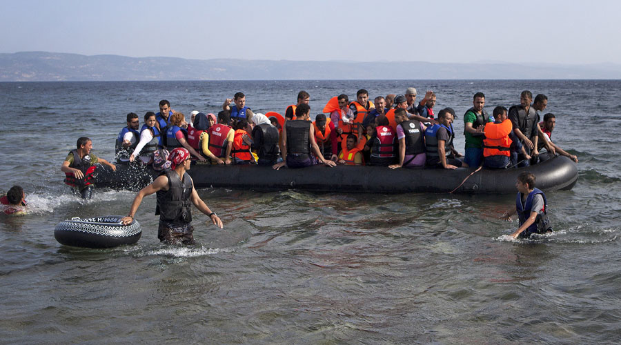 Syrian refugees arrive on a dinghy on the Greek island of Lesbos, September 7, 2015. © Dimitris Michalakis